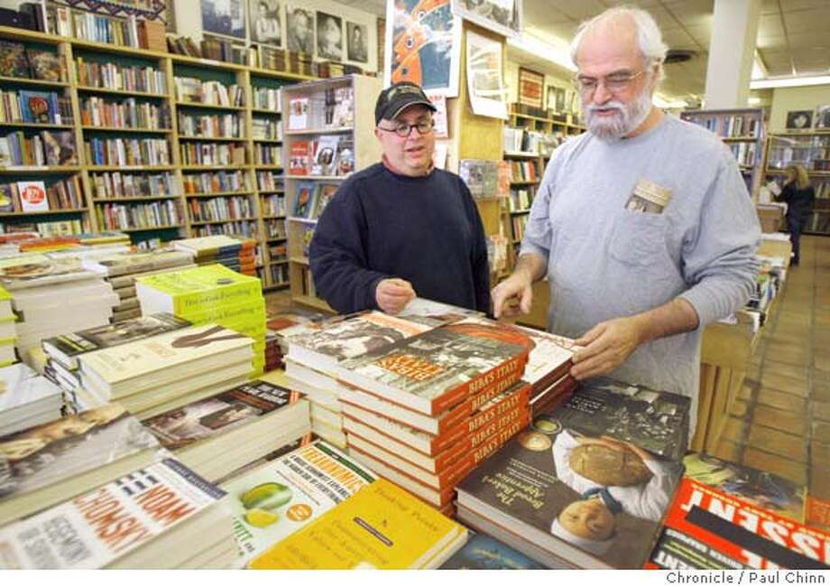 Bookstore owner Don Pretari (left) and his business partner Bob Brown look over a display of new books at Black Oak Books in Berkeley, Calif. on Wednesday, Jan. 10, 2007.  PAUL CHINN/The Chronicle  **Don Pretari, Bob Brown MANDATORY CREDIT FOR PHOTOGRAPHER AND S.F. CHRONICLE/ - MAGS OUT Photo: PAUL CHINN