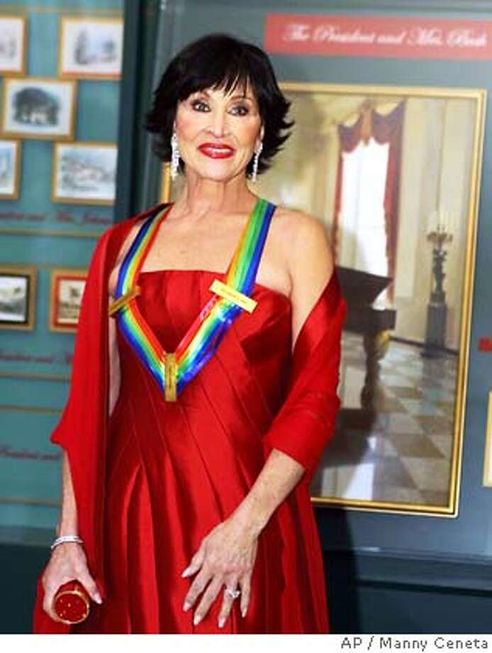 �Kennedy Center honoree Chita Rivera poses upon her arrival in the White House December 8, 2002. President George W. Bush and the first lady Laura Bush received the honorees at the White House prior to the gala performance. RETUTERS/Manny Ceneta CAT 0 Photo: STR