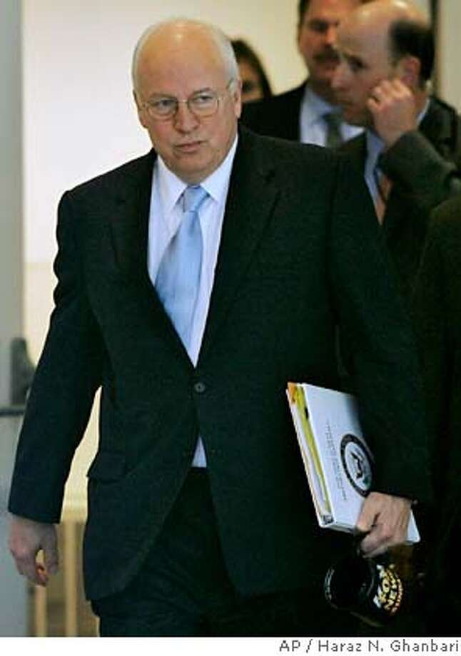 "Vice President Dick Cheney leaves after an interview with Fox News Sunday at their offices in Washington Sunday, Jan. 14, 2007. Cheney said that congressional opposition will not influence President Bush's plans to send more troops to Iraq. ""The president is the commander in chief. He's the one who has to make these tough decisions,"" Cheney said during the interview. (AP Photo/Haraz N. Ghanbari) Photo: HARAZ N. GHANBARI"