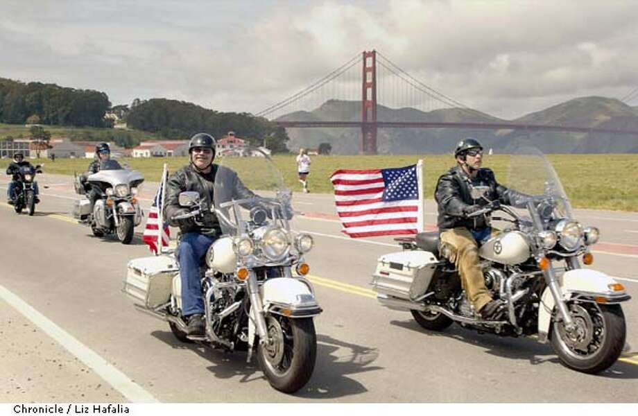 About 200 motorcyclists rode through San Francisco passing crissy field, many carrying their flags. (PHOTOGRAPHED BY LIZ HAFALIA/THE SAN FRANCISCO CHRONICLE) Photo: LIZ HAFALIA