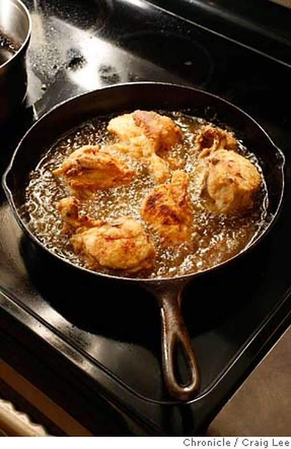 """CHICKEN17_085_cl.JPG  Photo for story on fried chicken. Food photo styled by Amanda Gold. Photo of """"Best Way Chicken"""" in the frying pan.  Event on 1/5/07 in San Francisco. photo by Craig Lee / The Chronicle Photo: Photo By Craig Lee"""