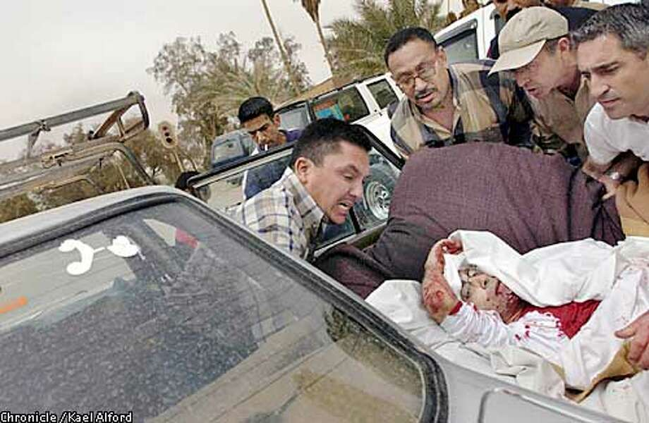 Telecinco cameraman Jose Couso, 37, as he is carried by colleagues from the parking lot of the Hotel Palestine in Baghdad after US troops fired a tank round at the 15th floor of the building where Reuters had its office. Most of the foreign reporters in Baghdad stay in rooms at the Palestine. Couso died in hospital from his injuries to the jaw and leg. He leaves a wife and two children. 8 April 2003  Photo: Kael Alford Photo: Kael Alford