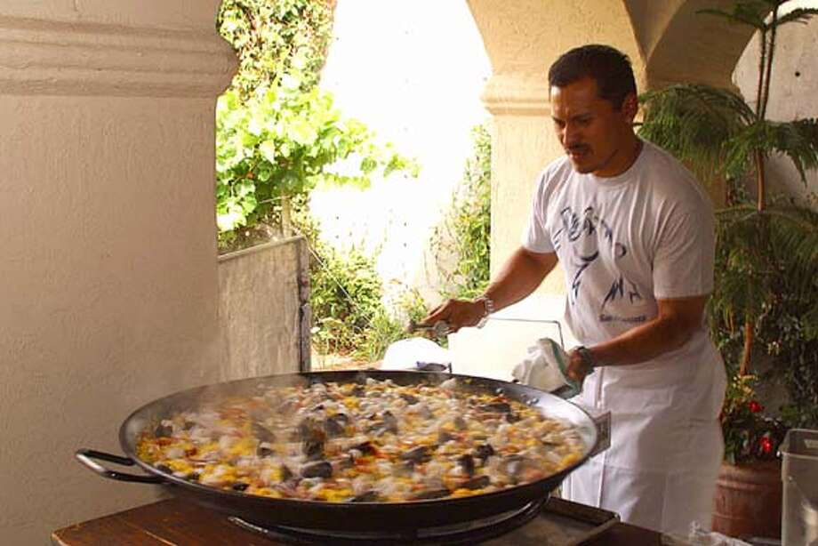 A man (we don't know his name) prepares paella at the 2002 Catalan Festival at the Gloria Ferrer Champagne Caves.