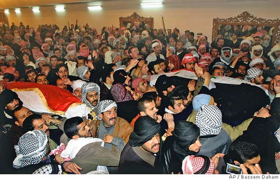 People carry the coffins of Barzan Ibrahim, Saddam's half brother and former intelligence chief, and Awad Hamed al-Bandar, the former head of Iraq's Revolutionary Court who were executed at dawn Monday in Baghdad, in Ouja, 115 kilometers (70 miles) north of Baghdad, Iraq, Monday Jan. 15, 2007. (AP Photo/Bassem Daham) Photo: BASSEM DAHAM