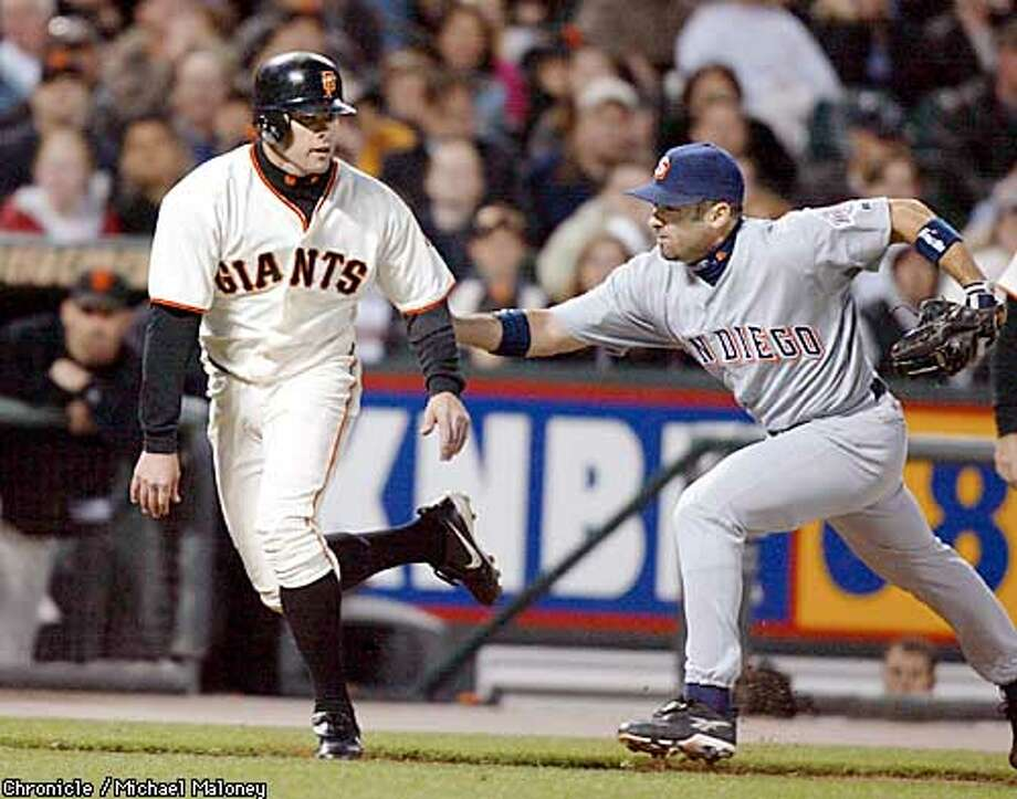 J.T. Snow gets caught between 3rd and home on a single by Marquis Grissom in the 2nd inning. San Diego's 3rd baseman Lou Merloni tags him out.  SF Giants vs San Diego Padres at PacBell Park, San Francisco, CA.  CHRONICLE PHOTO BY MICHAEL MALONEY Photo: MICHAEL MALONEY