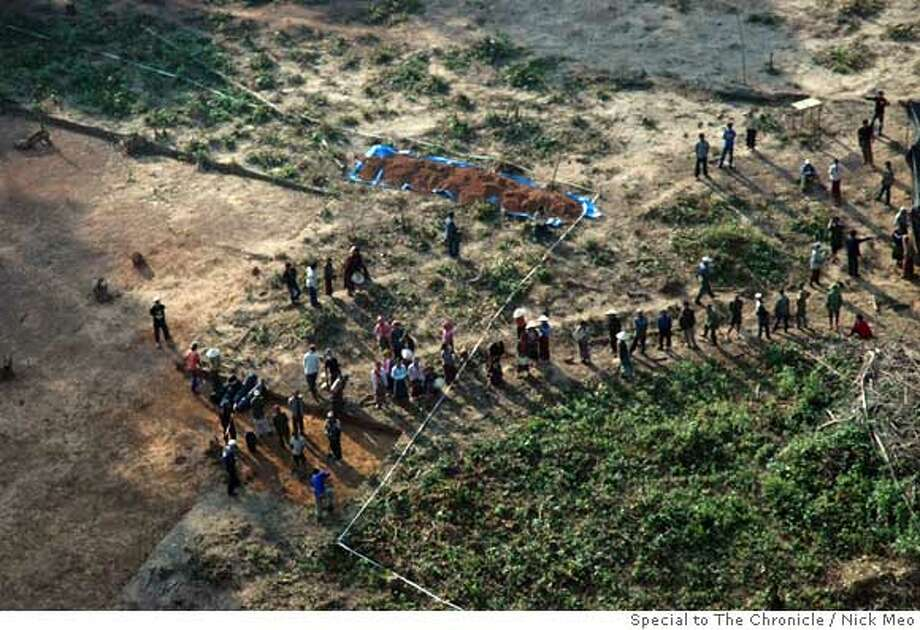 Picture for foreign � shows Americans searching for MIAs in South-East Asia Teams of American servicemen and women search the jungle in Laos for human remains at aircraft crash sites dating from the secret war in the 1960s and 70s. Picture shows lines of workers on the site of the excavation. Photo by Nick Meo/Special to The Chronicle  Ran on: 01-14-2007 Photo: Nick Meo/Special To The Chronicl