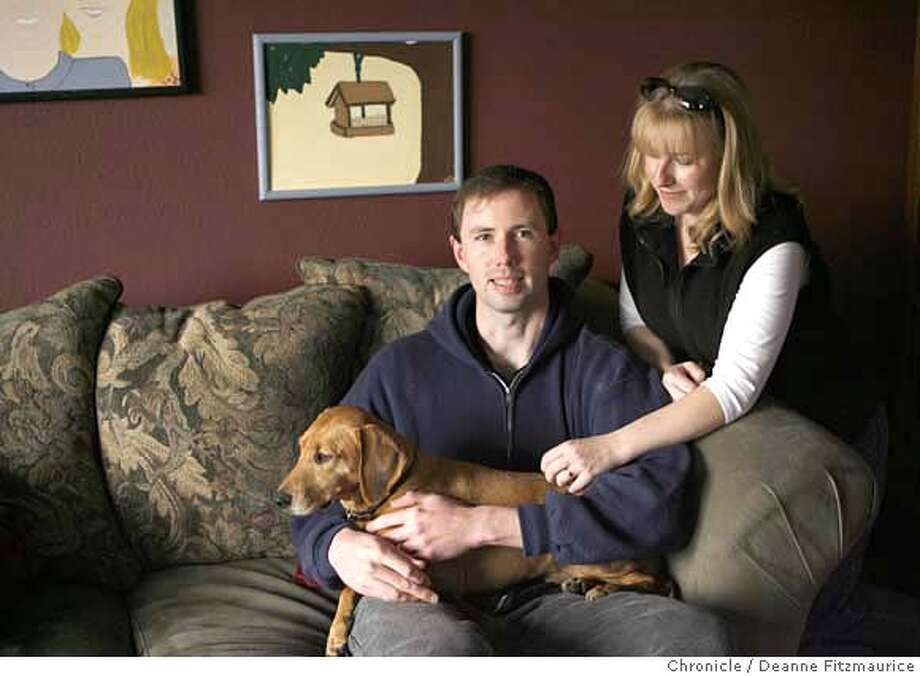 nevius14_0136_df.jpg  IN CAPTION BE SURE TO STATE THAT THIS WAS DURING A PORTRAIT SESSION WITH THE CHRONICLE. Josh and Liz Erickson are hoping that Josh does not get deployed again to Iraq. They are with their dog, Rudy.  Photographed in Santa Rosa on 1/12/07. Photo / Deanne Fitzmaurice Mandatory credit for photographer and San Francisco Chronicle. /Magazines out. Photo: Deanne Fitzmaurice