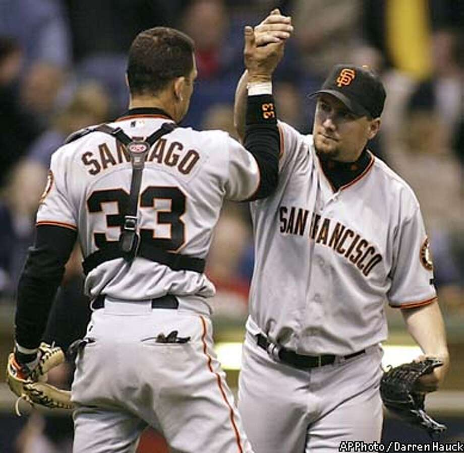 San Francisco Giants' closing pitcher Scott Eyre, right congratulates catcher Benito Santiago (33) after beating the Milwaukee Brewers 6-5, Saturday, April 5, 2003 in Milwaukee. (AP Photo/Darren Hauck) Photo: DARREN HAUCK