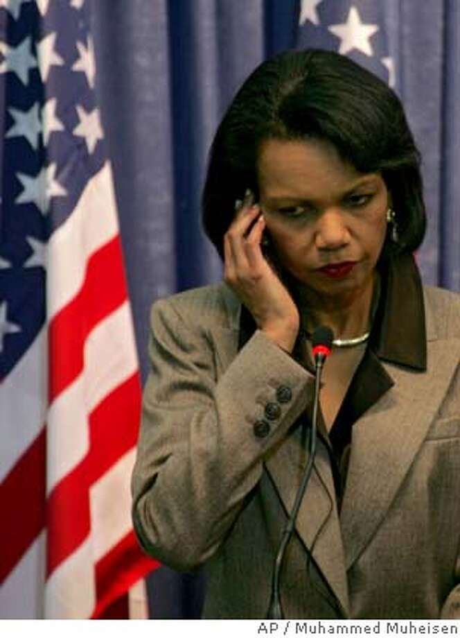 United States Secretary of State Condoleezza Rice, listens to Palestinian President Mahmoud Abbas, not seen, during a joint press conference in the West Bank city of Ramallah, Sunday, Jan. 14, 2007. Rice launched her latest tour of the Mideast on Saturday with an effort to nudge Israel and the Palestinians closer to a political accommodation. (AP Photo/AP Photo/Muhammed Muheisen) Photo: MUHAMMED MUHEISEN