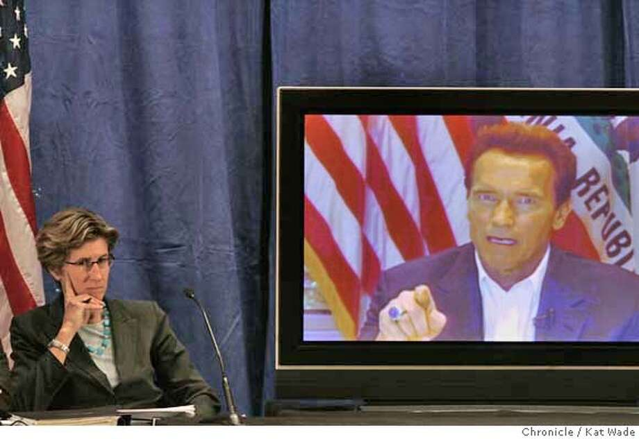 GOV_HEALTHCARE_0068_KW_.jpg  Governor Arnold Schwarzenegger (RIGHT) (VIA SATELITE due to his broken leg and restrictions on traveling) announces his health care reforms plans while Kim Belshe, (LEFT) Secretary California Health and Human Services Agency, listens before detailing the governor's plan with a panel of speakers at the California Department of Health Services auditorium in Sacramento Monday January 7, 2007. Kat Wade/The Chronicle Mandatory Credit for San Francisco Chronicle and photographer, Kat Wade, Mags out Photo: Kat Wade