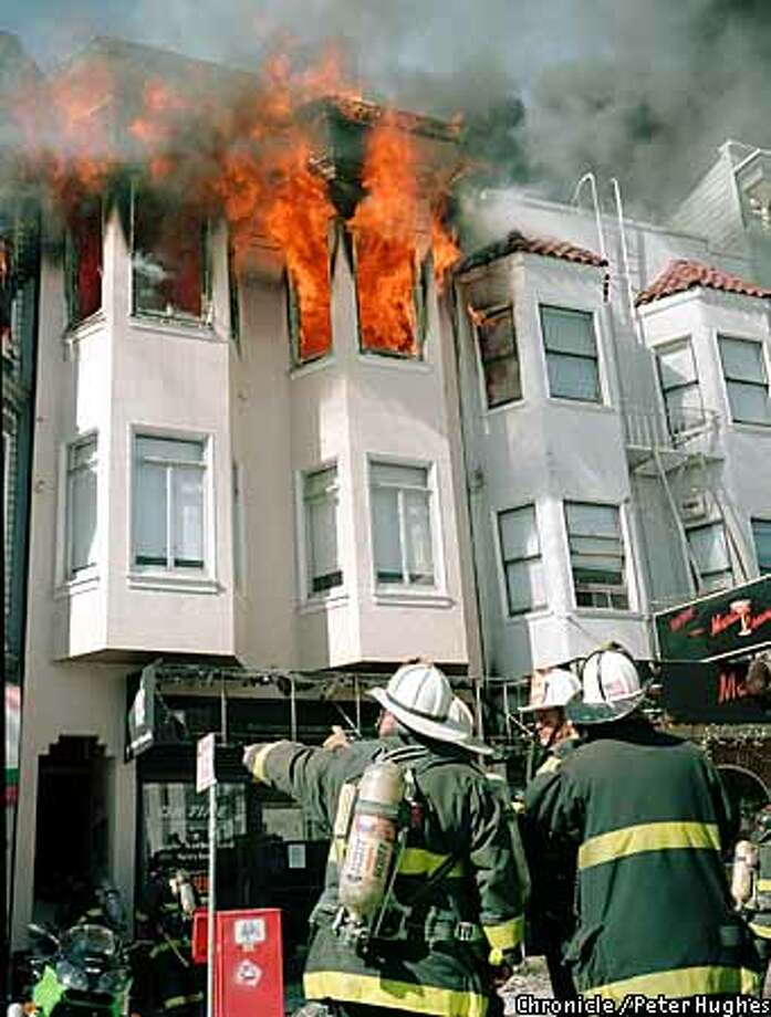 Firefighters work on a fire at 532 Greeen Street in San Francisco, April 7, 2003.  Special to The Chronicle Peter Hughes  ONE TIME USE ONLY PLEASE CONTACT PHOTOGRAPHER FOR RIGHTS