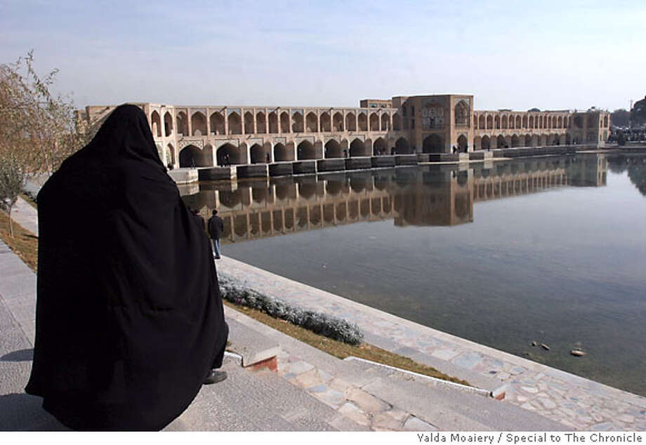 Woman near Khaju Bridge, Esfahan, Iran Situated on the north bank of the Zayandeh River at an elevation of about 5,200 feet, Esfahan is roughly 210 miles south of the capital city of Tehran. Photo credit: Yalda Moaiery Photo: Yalda Moaiery