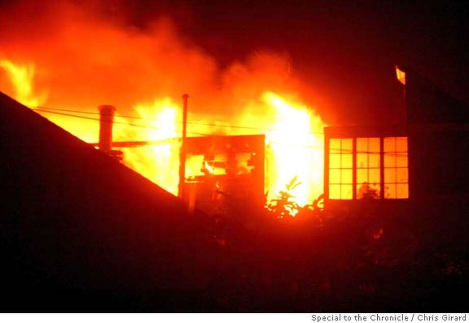 Flames rise from a five-alarm blaze on the top floor of an apartment building on 16th St. in the Mission District Fridy morning. The fire spread to several other adjacent buildings before being brought under control. Photo: CHRIS GIRARD/SPECIAL TO THE CHRONICLE