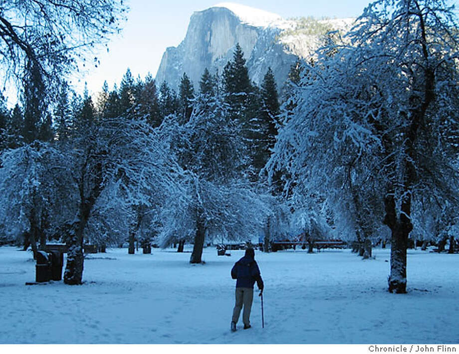 TRAVEL YOSEMITE -- Half Dome from Curry Village in winter. Photo: John Flinn