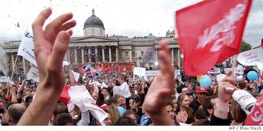 Confetti comes down on the crowds in London's Trafalgar Square who are celebrating to the announcement by the International Olympic Committee that London won the bid to host the 2012 Olympic Games, Wednesday, July 6, 2005. (AP Photo/ Max Nash) Photo: MAX NASH