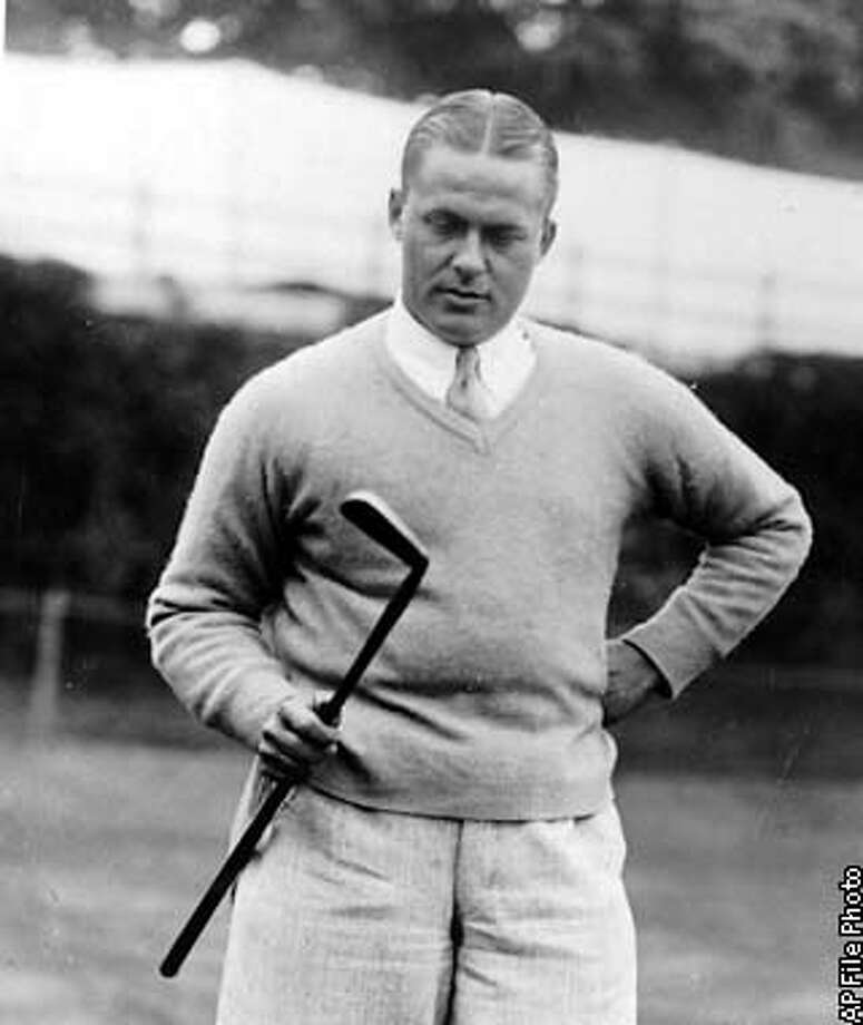 """FILE--Amateur golfer Bobby Jones looks at his famous putter """"Calamity Jane"""" at the Brae Burn Country Club in Newton, Mass in this Sept. 12, 1928 photo. (AP Photo/file)"""
