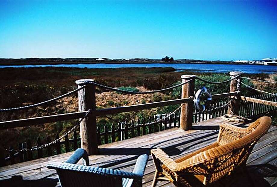 The view from the deck at Moss Landing's Captain's Inn, where all the rooms are decorated with boat motifs. The town has a varied history; it served as a center of liquor smuggling in the 1920s. Photo by Aeron Noe, special to the Chronicle