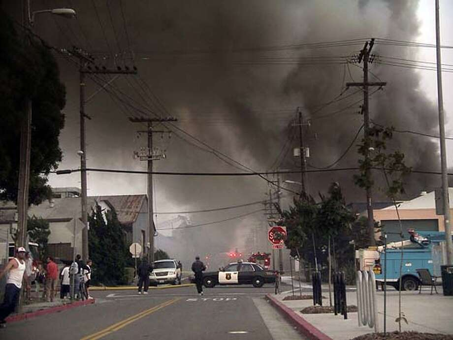 Ran on: 06-30-2005  Smoke rises from a building used by Creedence Clearwater Revival as rehearsal space in the 1960s.