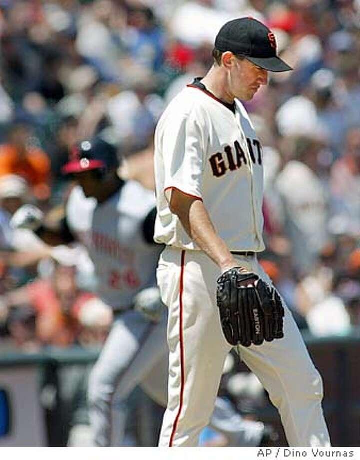 ** CORRECTS PLAYERS IN BACKGROUND TO WILY MO PENA, NOT JASON LA RUE, CORRECTS TO 3-RUN HOME RUN, NOT 2-RUN ** San Francisco Giants starter Kirk Rueter goes back to the mound after giving up a 3-run home run to the Cincinnati Reds' Wily Mo Pena, Monday, July 4, 2005 in San Francisco. AP Photo/Dino Vournas) Photo: DINO VOURNAS