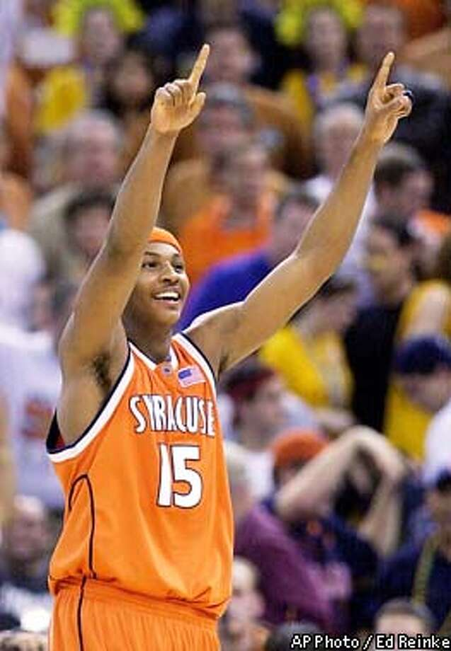 Syracuse's Carmelo Anthony reacts as time runs out in the semifinals game against Texas Saturday, April 5, 2003, at the Final Four in New Orleans. Anthony was the leading scorer with 33 in Syracuse's 95-84 win. Syracuse will face Kansas in the finals on Monday. (AP Photo/Ed Reinke) Photo: ED REINKE