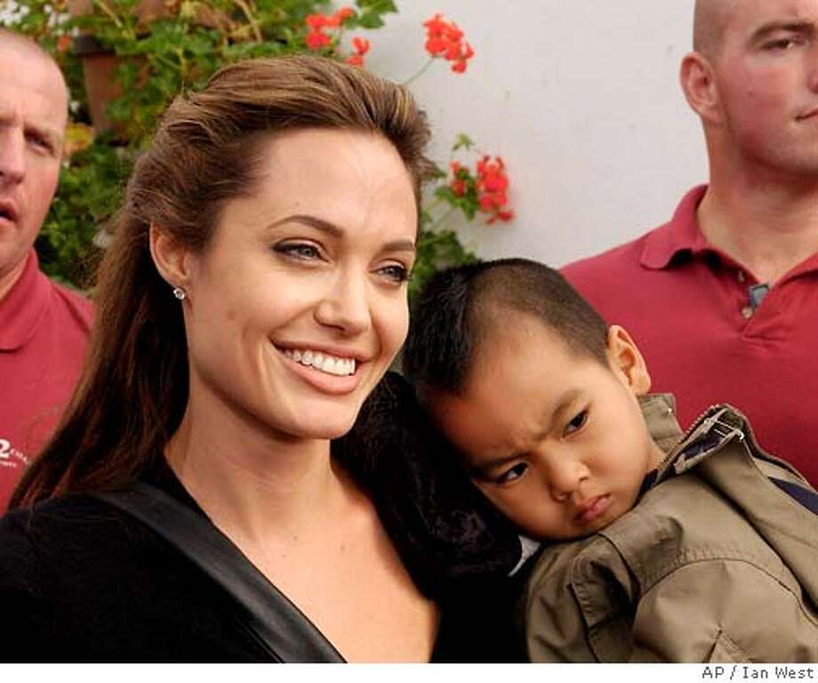 ** RETRANSMIT TO CHANGE TRANS. REF. NUMBER ** Movie star Angelina Jolie with her son Maddox at the Live 8 Africa Calling concert, held at the Eden Project in Cornwall, England, July 2, 2005. Jolie is adopting another child, an orphaned Ethiopian baby girl. (AP Photo/Ian West/PA) ** UNITED KINGDOM OUT ** Photo: IAN WEST