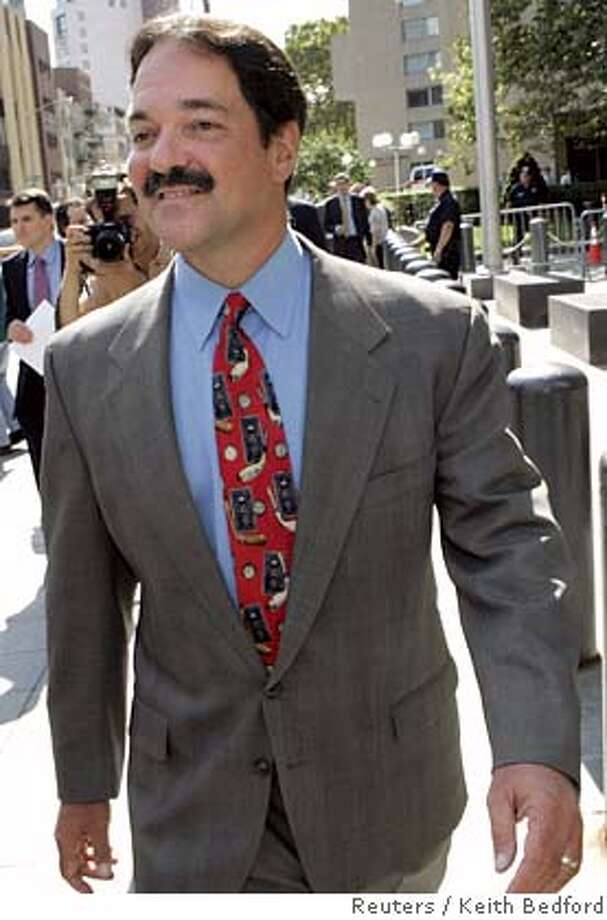 Former banker Frank Quattrone exits Federal court in New York August 22, 2006. A U.S. federal court judge on Tuesday approved a settlement that would let Quattrone avoid a third trial for obstructing justice, opening the door for him to resume his career on Wall Street. REUTERS/Keith Bedford (UNITED STATES) Photo: KEITH BEDFORD