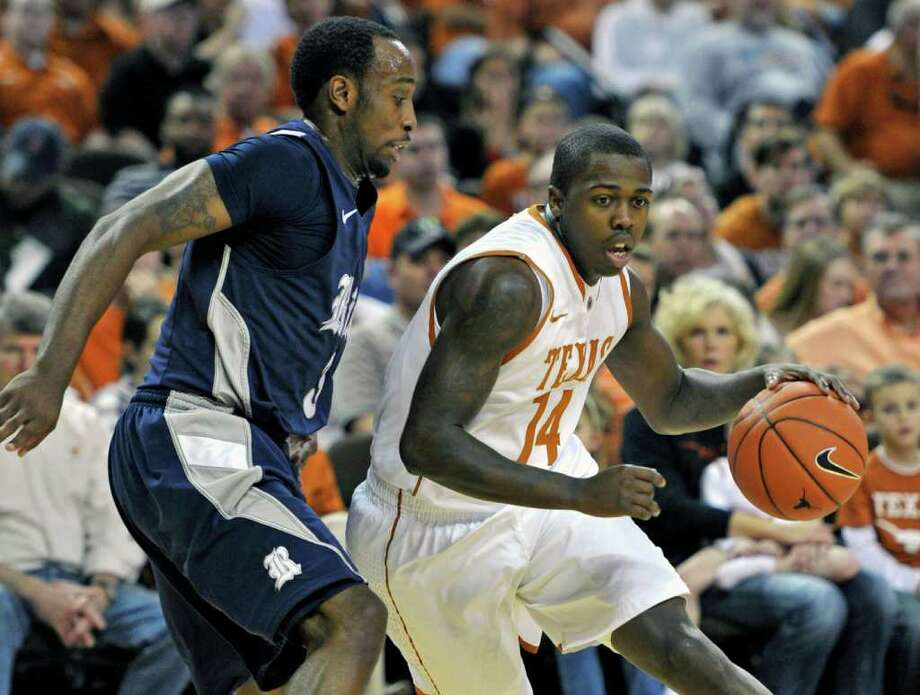 The Chronicle of Higher Education cited three instances of alleged academic misconduct involving former players P.J. Tucker, J'Covan Brown (pictured abover), and Martez Walker. Photo: Michael Thomas, Associated Press / FR65778 AP
