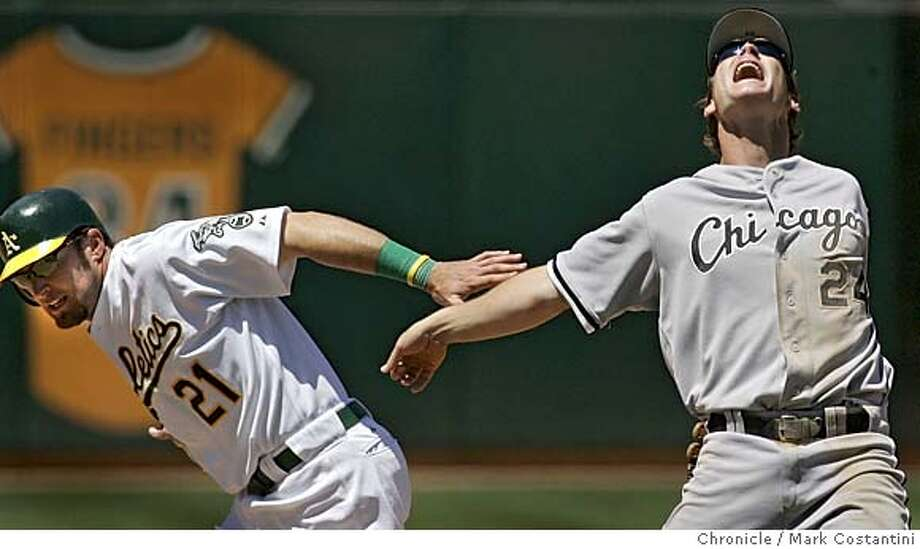 WHITE SOX THIRDBASEMAN JOW CREDE YELLS AS HE TRIES TO JUDGE AN INFIELD FLY AND HIT HIT BY A'S BASERUNNER MARK KOTSAY AS HE TRIES ADVANCE TO THIRD BASE.  A'S BEAT THE CHICAGO WHITE SOX AT THE OAKLAND COLISEUM. Photograph by Mark Costantini/S.F. Chronicle. Photo: Mark Costantini