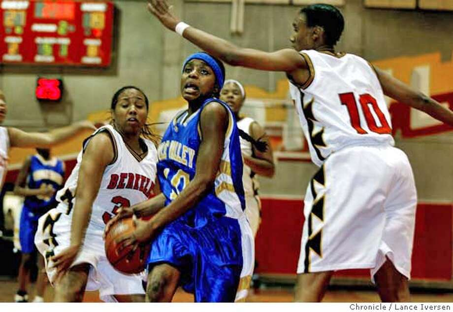 PREPS_BERKELEY_1509.JPG  Pinole Valley #10 Marnique Arnold drives to the basket past Berkeley's #33 Amber Todd and #10 Jennifer Gross. Pinole Valley High Vs. Berkeley High in Girls basketball. . January12, 2007 .BERKELEY.  By Lance Iversen/San Francisco Chronicle Photo: By Lance Iversen