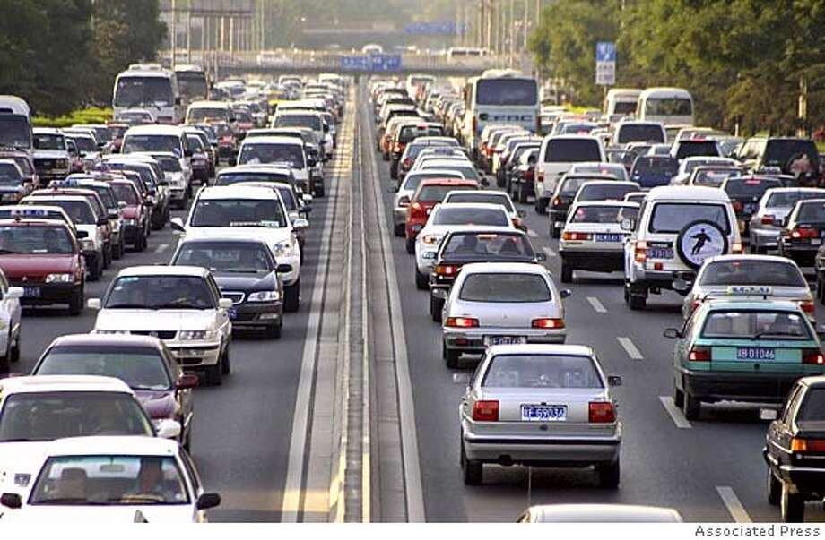 ** ADVANCE FOR SUNDAY, MAY 29 **FILE**Cars clog Beijing's Second Ring Road in the afternoon rush hour Thursday, June 10, 2004. Car sales in China are expected to total as many as 10 million vehicles annually by 2010. In Beijing alone, more than 1000 new cars hit the city's streets each day, resulting in major traffic problems and much higher energy use. (AP Photo/str) Ran on: 05-29-2005  About 8 percent of Canada's oil is produced by liquefying oil found in tar sands. Workers here overlook Suncor's tar sands processing plant in Fort McMurray, Alberta. HFR 05-29-05. ADVANCE FOR SUNDAY, MAY 29