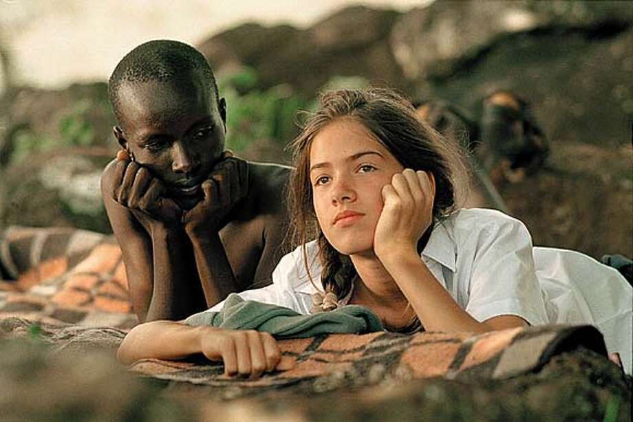 "THIS IS A HANDOUT IMAGE. PLEASE VERIFY RIGHTS. Silas Kerati as Jogona and Karoline Eckertz as Regina in ""Nowhere in Africa."""