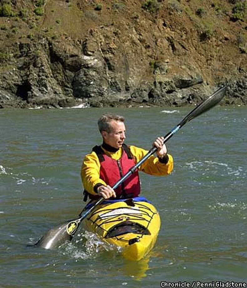 KAYAK5-C-06MAR03-MG-PG J.T. Whittaker a kayaker with the California Canoe & Kayak at Jack London Sq. in Oakland. Big boat driver, thanks to Capt'n Gary Sullivan of the Waterfront Hotel in Jack London Sq for getting us to our locations. SAN FRANCISCO CHRON