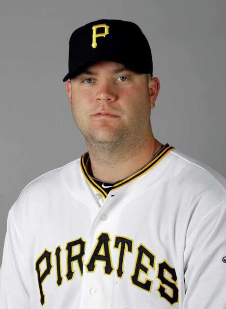 FILE - This 2011, file photo shows Pittsburgh Pirates baseball player  Chris Snyder.  Pittsburgh police say a man attacked the wife of Pirates catcher Chris Snyder in a traffic dispute in pittsburgh, while Snyder sat in the car, unable to get out because he'd had back surgery, Wednesday, June 15, 2011. (AP Photo/Eric Gay, File) Photo: Eric Gay / AP2011