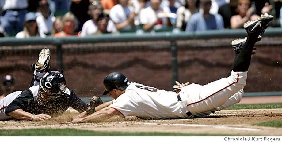J.T. Snow scores from second of a hit from Moises Alou in the first inning.  Cincinnati Reds vs the San Francisco Giants. 7/4/05 in San Francisco,CA.  KURT ROGERS/THE CHRONICLE Photo: KURT ROGERS