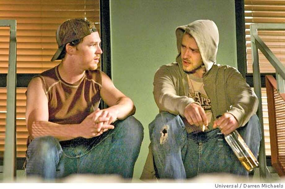 "�In this photo provided by Universal, Elvis Schmidt (Shawn Hatosy) and Frankie Ballenbacher (Justin Timberlake) discuss what to do with their hostage in ""Alpha Dog."" (AP Photo/Universal/Darren Michaels) Photo: Darren Michaels"
