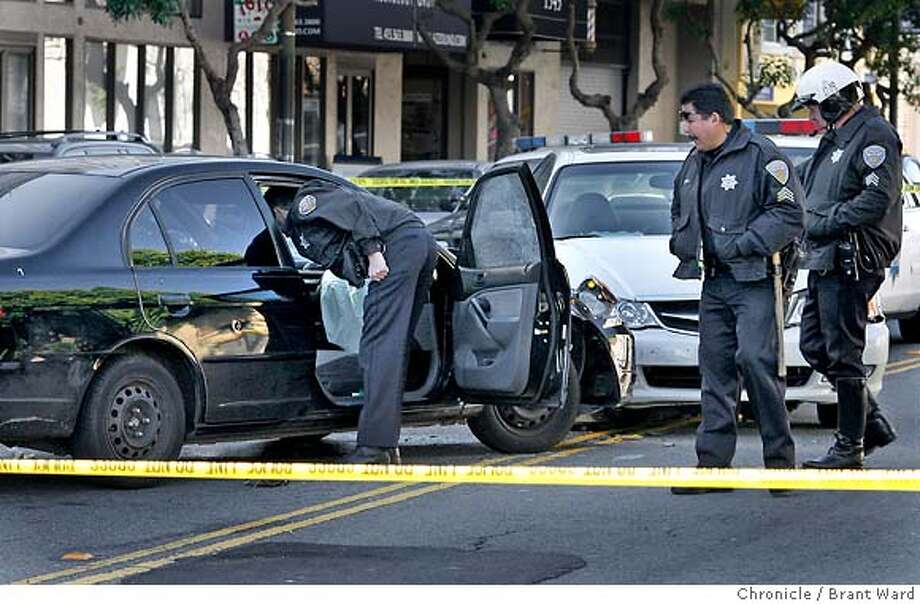 Police took a closer look at a new Honda Civic involved in the incident. A bullet hole broke the passenger side window.  San Francisco police are investigating a car crash and subsequent shooting on Russian hill on Broadway between Polk and Van Ness Avenue. The investigation closed down several blocks. {Brant Ward/San Francisco Chronicle}1/11/07 Photo: Brant Ward