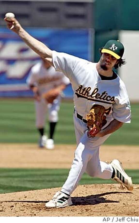 Oakland Athletics' Dan Haren pitches in the third inning against the Seattle Mariners in Oakland, Calif., on Thursday, June 30, 2005. (AP Photo/Jeff Chiu) Photo: JEFF CHIU