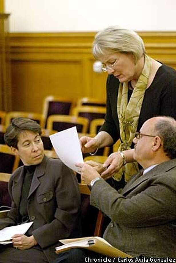 "San Francisco Human Rights Commissioner, Theresa Sparks, standing, speaks with Larry Brinkin, right, and Cynthia Goldstein of the commission during a earing on Thursday, March 27, 2003. Sparks was honored as ""Woman of the Year,"" by the California State Assembly. (CARLOS AVILA GONZALEZ/SAN FRANCISCO CHRONICLE) Photo: CARLOS AVILA GONZALEZ"