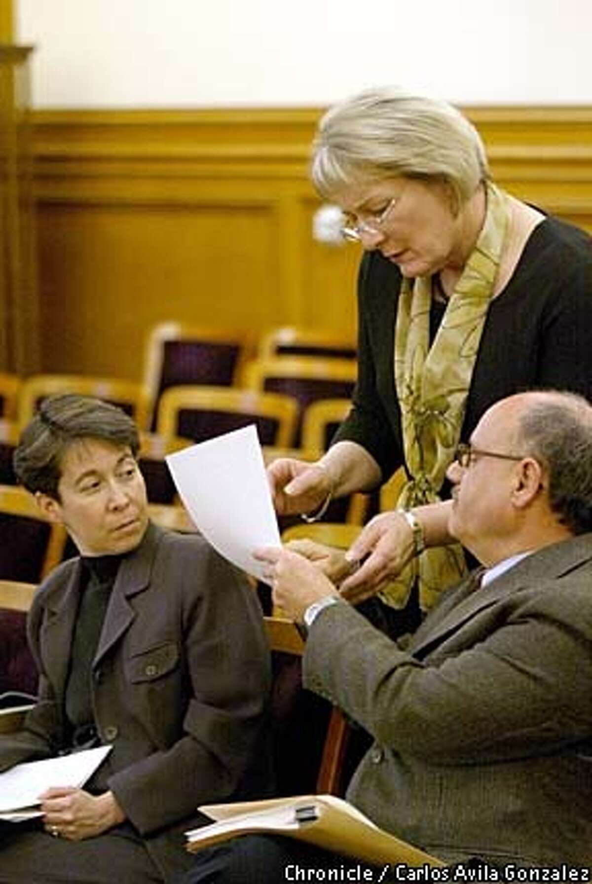 """San Francisco Human Rights Commissioner, Theresa Sparks, standing, speaks with Larry Brinkin, right, and Cynthia Goldstein of the commission during a earing on Thursday, March 27, 2003. Sparks was honored as """"Woman of the Year,"""" by the California State Assembly. (CARLOS AVILA GONZALEZ/SAN FRANCISCO CHRONICLE)"""