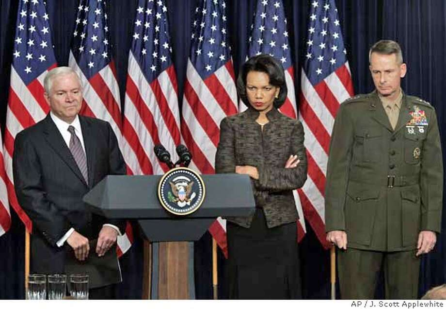 Defense Secretary Robert Gates, left, and Secretary of State Condoleezza Rice, center, and Joints Chiefs Chairman Gen. Peter Pace, meet with reporters in the Eisenhower Executive Office Building adjacent to the White House in Washington, Thursday, Jan. 11, 2007 to discuss President Bush's Iraq plans. (AP Photo/J. Scott Applewhite) Photo: J. SCOTT APPLEWHITE