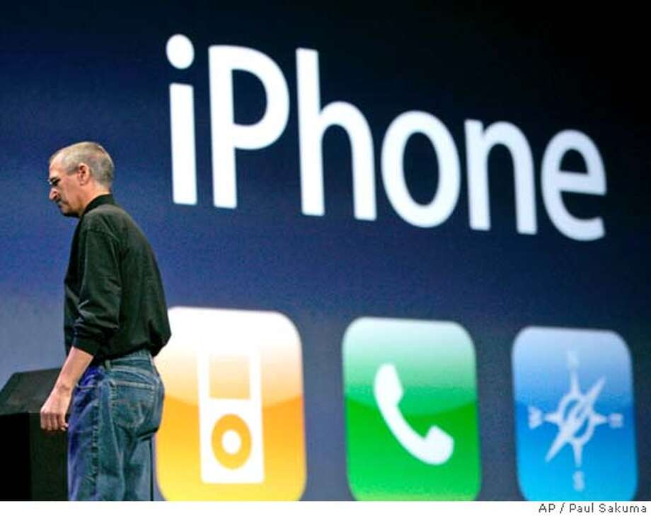 """Apple CEO Steve Jobs introduces the Apple's new iPhone during his keynote address at MacWorld Conference & Expo in San Francisco, Tuesday, Jan. 9, 2007. Cisco Systems Inc. said Wednesday, that it is suing Apple Inc. in federal court over Apple's use of Cisco's registered iPhone trademark for its new handheld device. Cisco has owned the trademark on the name """"iPhone"""" since 2000, when it acquired the company that originally registered the name, InfoGear Technology Corp. (AP Photo/Paul Sakuma) Photo: PAUL SAKUMA"""
