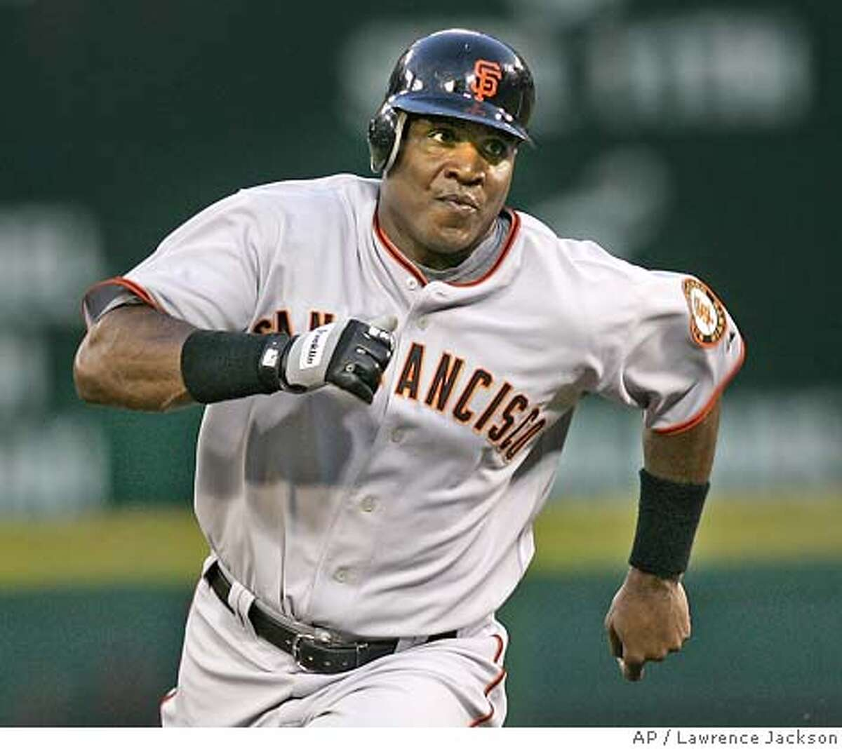 ** FILE ** San Francisco Giants' Barry Bonds rounds second base on his way to third on a Ray Durham double against the Washington Nationals in the fourth inning of a baseball game in Washington, in this July 26, 2006 file photo.. (AP Photo/Lawrence Jackson)