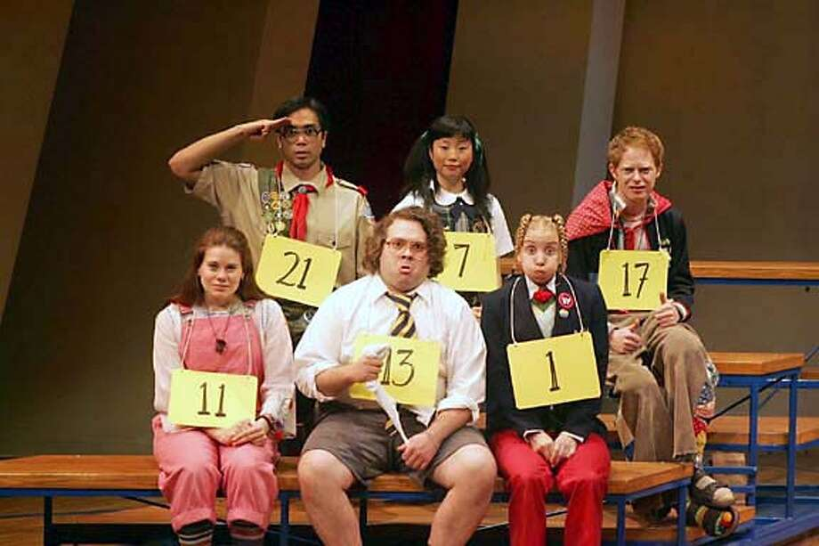 In this photo provided by The Publicity Office, (Front row): Celia Keenan-Bolger, Dan Fogler, Sarah Saltzberg; (back row): Jose Llana, Deborah S. Craig, Jesse Tyler Ferguson, the young spellers in ``The 25th Annula Putnam County Spelling Bee,'' a new musical now playing at Broadway's Circle in the Square. (AP Photo/The Publicity Office/ Joan Marcus) Photo: JOAN MARCUS