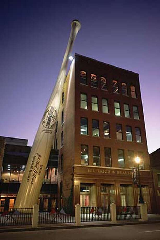 World's Biggest Baseball Bat - The World's Biggest Baseball Bat marks the entrance to the museum. It's 120 feet tall and weighs 68,000 pounds. The bat is hand painted steel.  To go with wire story on Louieville Slugger Museum. Louieville on 6/29/05. / Louieville Slugger Museum