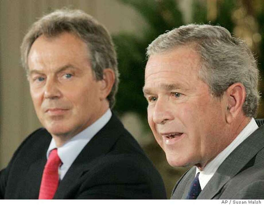 ** FILE ** President Bush, right, talks with reporters as British Prime Minister Tony Blair listens during a news conference at the White House in Washington in this June 7, 2005 file photo. As he heads into the Group of Eight summit meeting starting Wednesday, July 6, 2005, in Scotland, Bush seems almost to have a fixation with getting the troubled continent on the right track. The administration said two weeks ago that aid to Africa has tripled since 2001; it plans to double the 2004 level to $8.6 billion by 2010. (AP Photo/Susan Walsh, File) Ran on: 07-04-2005  Britain's Tony Blair (left) will host President Bush and other G-8 leaders. Ran on: 07-04-2005 Ran on: 07-04-2005  Britain's Tony Blair (left) will host President Bush and other G-8 leaders. Photo: SUSAN WALSH