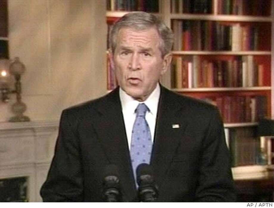 In this video frame grab taken from television, President Bush addresses the nation from the White House library in Washington, Wednesday Jan. 11, 2007. (AP Photo/APTN)