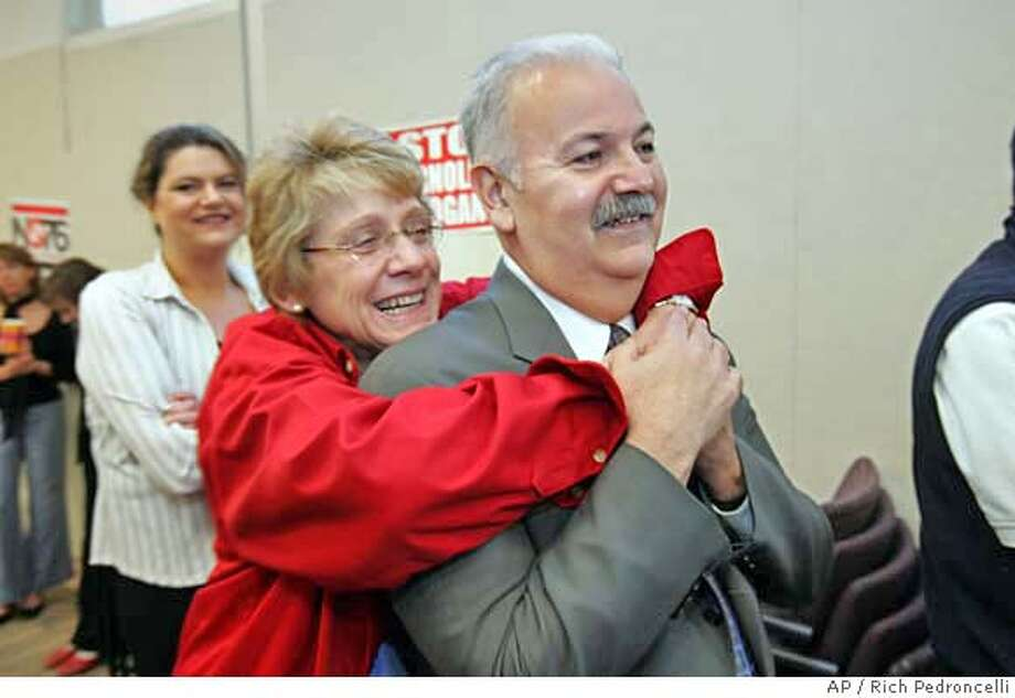 California Teachers Association members Carolyn Doggett, center , and Joe Nunez, right, smile with others as they attend a news conference held by the Alliance for a Better California, held in Sacramento, Calif., Wednesday, Nov. 9, 2005. The Alliance, a coalition of unions representing teachers, nurses, firefighters and correctional officers, hailed the defeat of Gov. Arnold Schwarzenegger's ballot intitatives calling it a victory for the working class.(AP Photo/Rich Pedroncelli) Ran on: 11-10-2005  Carolyn Doggett and Joe Nunez, both members of the California Teachers Association, celebrate at a news conference in Sacramento. Photo: RICH PEDRONCELLI