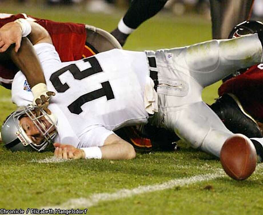 RAIDERS110-C-26JAN03-SP-LM  Rich Gannon is sacked and fumbles in the final two minutes of the super bowl. the Bucs beat the Raiders in San Diegoo at the Superbowl. Photo by Liz Mangelsdorf/ Chronicle Photo: Liz Mangelsdorf