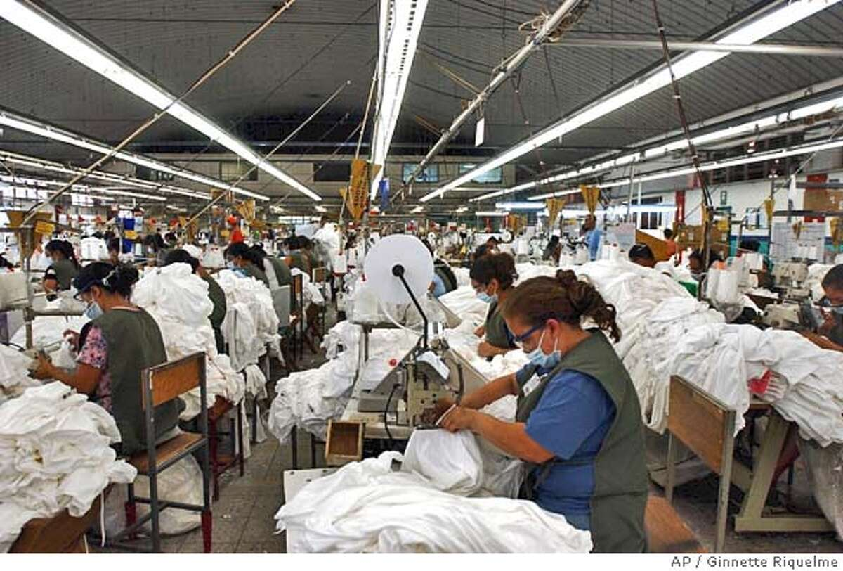 Honduran workers sew t-shirts at the Confecciones Internacionales Manufacture, on Friday, June 17, 2005, in Tegucigalpa, Honduras. Confecciones Internacionales exports all of its products to the US, and if Congress in the US government approves Central American Free Trade Agreement, Honduran manufacturers can grow up 20 to 30%, according to Honduran Manufacturers Association. The free trade agreement includes the United States, El Salvador, Nicaragua, Guatemala, Honduras, Costa Rica and the Spanish-speaking Caribbean nation of the Dominican Republic. It would remove most tariffs and other trade barriers between the nations. (AP PHoto/Ginnette Riquelme) **EFE OUT**PHOTO MADE AVAILABLE ON MONDAY, JUNE 20, 2005.