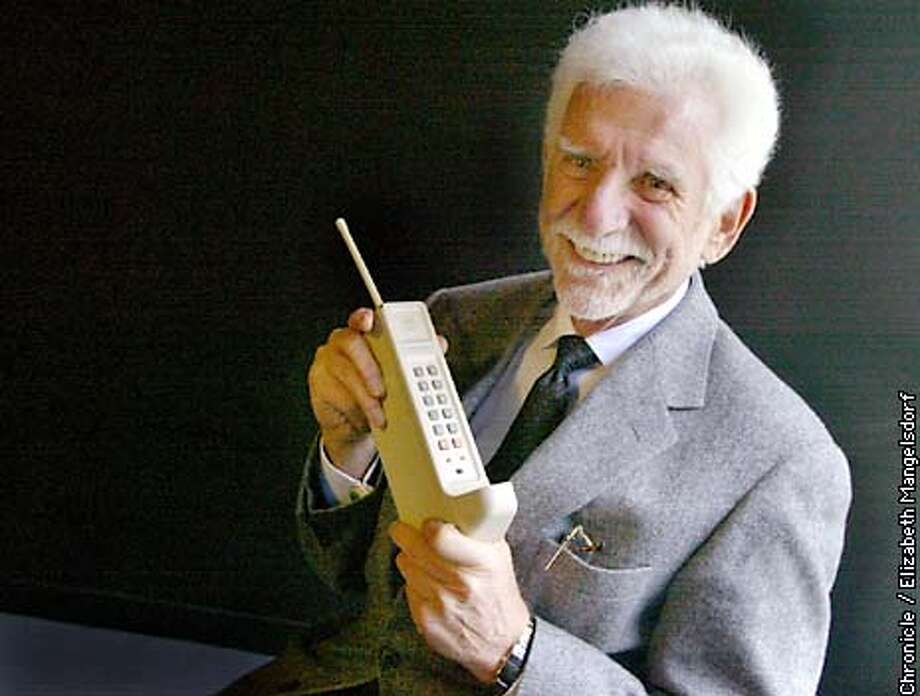 Martin Cooper, considered the father of the cell phone, with the first cell phone he used 30 years ago. He is now Chief Executive of ArrayComm. Photo taken at Arraycomm office in San Jose. Photo by Liz Mangelsdorf/sf chronicle Photo: Liz Mangelsdorf